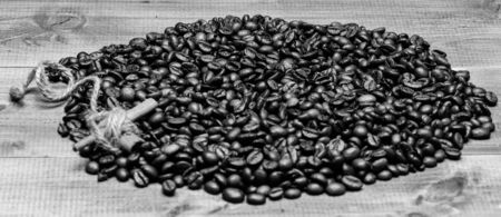Foto de Coffee for inspiration and energy charge. Beverage with caffeine and spices. Texture and background concept. Coffee shop or store. Degree of roasting coffee beans. Fresh roasted coffee beans. - Imagen libre de derechos
