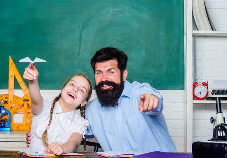 Foto de Developing caring learners who are actively growing and achieving. School learners leisure. Creating a community of learners. Teacher and schoolgirl. Man bearded pedagogue and pupil having fun - Imagen libre de derechos