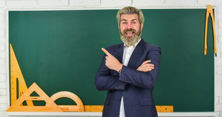 Photo for Teacher explain hard topic. Man teacher in front of chalkboard. Important information to remember. Teacher friend of learners. Steps that crucial to your success. Teachers enlighten path of success - Royalty Free Image