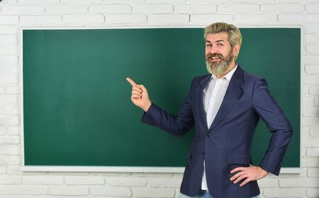 Photo for Announcement of free courses. Have good grade point average in high school. Teacher friend of learners. Teachers enlighten path of success. Teacher explain topic. Man teacher in front of chalkboard - Royalty Free Image