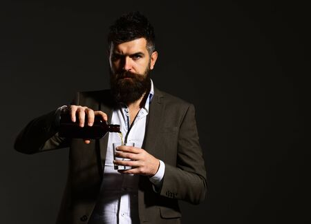 Foto de Sommelier with beard tasting alcohol. Partying and drinking concept - Imagen libre de derechos