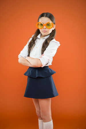 Photo for Goggles are more than just eyeglasses. Adorable little girl wearing fancy goggles on orange background. Cute small child with fashion goggles accessory. Choosing perfect party goggles - Royalty Free Image