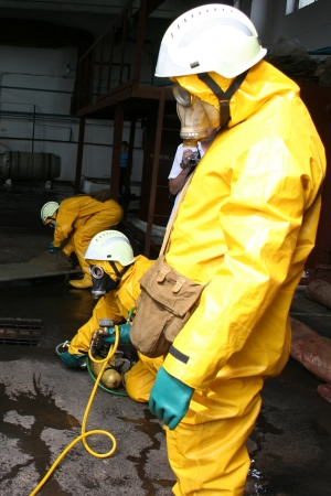 firefighters in chemical protection suit during the job