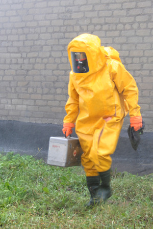 Man in chemical protection suit, carrying out the decontamination area