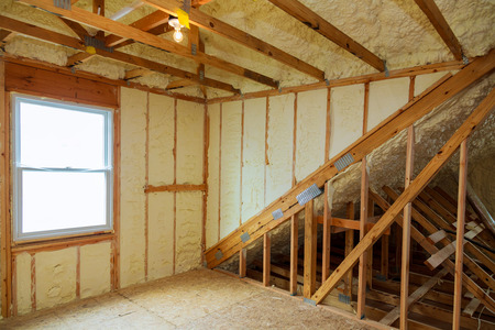 Photo for A room at a newly constructed home is sprayed with liquid insulating foam - Royalty Free Image