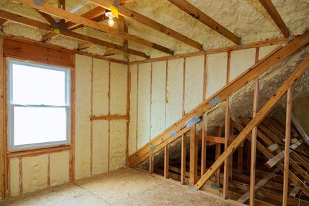 Foto de A room at a newly constructed home is sprayed with liquid insulating foam - Imagen libre de derechos
