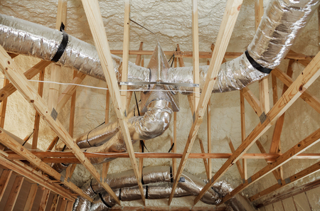 Foto de installation of heating system on the roof of the pipe house heating system with tubes, pipes, valves close up - Imagen libre de derechos