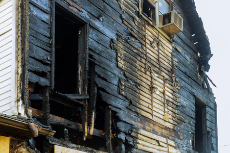 Photo for Abandoned building after fire house completely consumed by fire is burnt to the ground. - Royalty Free Image