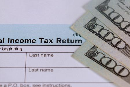 Photo pour Business concept pay tax USA Tax Form 1040 with 100 US dollar bills. - image libre de droit