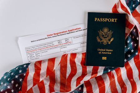 Photo pour United States passport of American vote registration form for presidential election with flag - image libre de droit