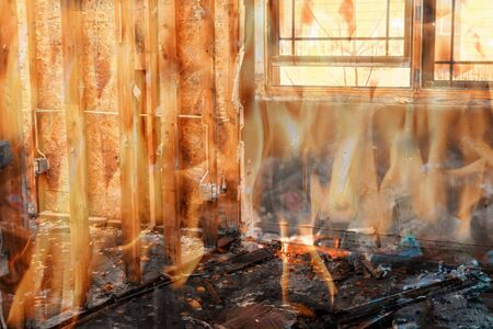 Photo for Burning apartment building side view in the destroyed burning wooden house - Royalty Free Image