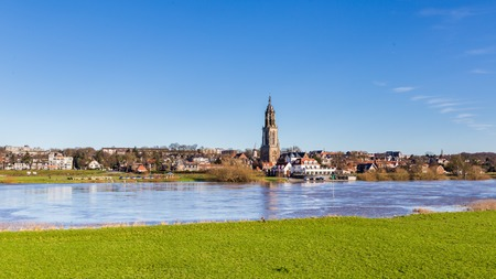 Photo for Landscape with a view on the flooded river Rhine and the small town  Rhenen in the Netherlands - Royalty Free Image