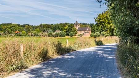 Photo for Dutch landscape with an ancient Roman church and a road  in Oosterbeek in the Netherlands - Royalty Free Image