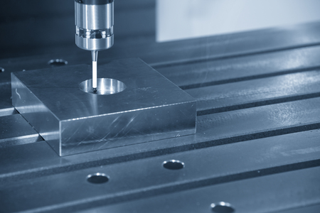 Foto de The CNC machine attach the CMM probe measure the dimension of circular hole. - Imagen libre de derechos
