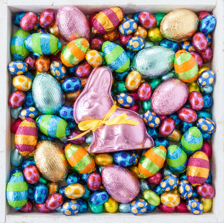 Photo for Bright cheerful easter eggs and chocolate bunny - Royalty Free Image
