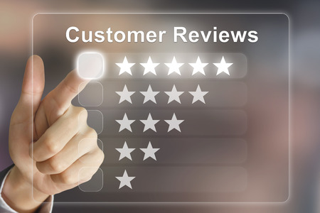 Photo pour business hand clicking customer reviews on virtual screen interface - image libre de droit