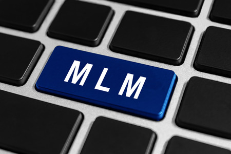 MLM or Multi Level Marketing blue button on keyboard, business concept