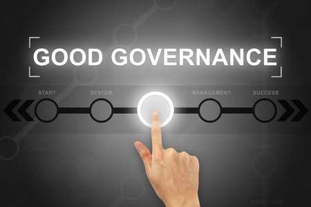 Foto de hand clicking good governance button on a touch screen - Imagen libre de derechos