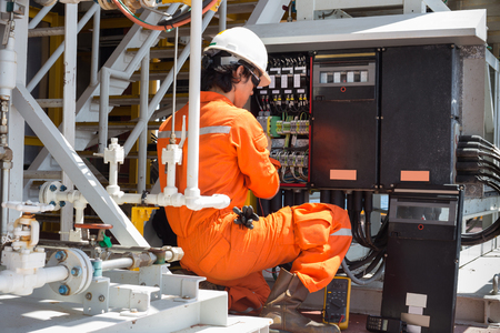 Foto de Electrical and instrument technician just maintenance electric system - Imagen libre de derechos