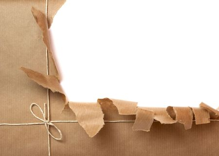 close up of package ripped on white background