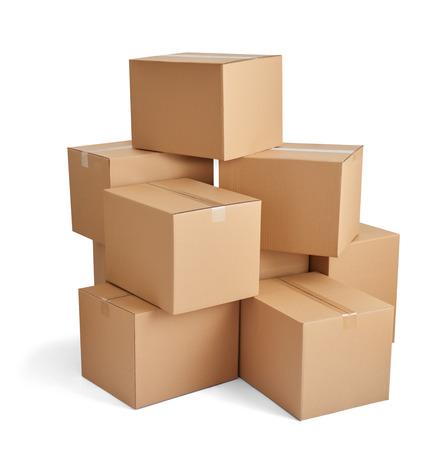 Foto de close up of  a stack of cardboard boxes on white background - Imagen libre de derechos