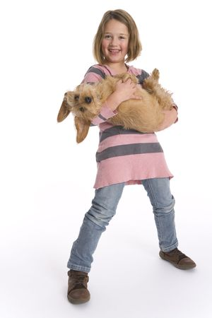 Photo for Little Girl Is Carrying Her Pet Dog Full Lenght - Royalty Free Image