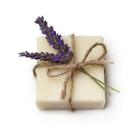 Foto de Piece of lavender soap and fresh lavender on white background - Imagen libre de derechos