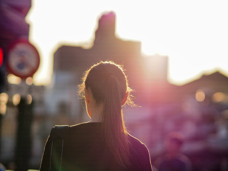 Photo for back of japanese business girl in sunset - Royalty Free Image