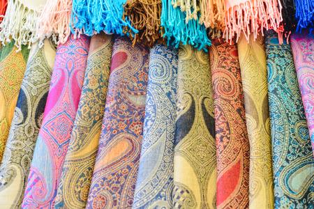 Foto de Many bright female scarfs and shawl close-up at shop - Imagen libre de derechos