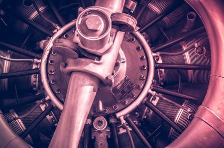 Photo pour red toned vintage aircraft engine and propeller closeup - image libre de droit