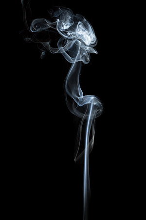 Foto de Abstract smoke isolated on dark background - Imagen libre de derechos