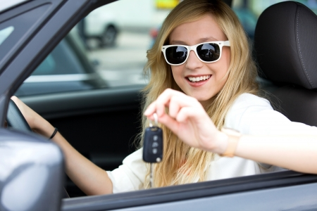 Smiling Woman Showing off New Car Keys
