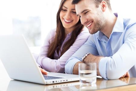 Business couple using laptop
