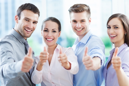 Foto de Business team with thumbs up - Imagen libre de derechos