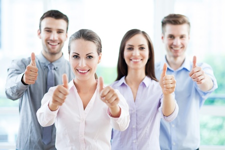 Photo pour Young business people showing thumbs up - image libre de droit