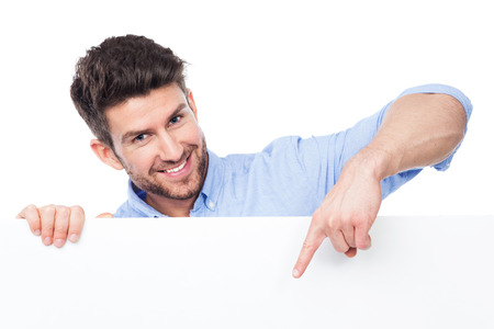 Photo for Man pointing at blank sign - Royalty Free Image