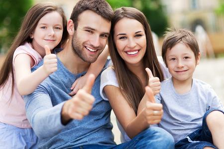 Photo pour Family showing thumbs up - image libre de droit