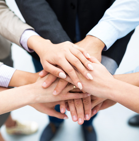 Photo for Business people stacking hands - Royalty Free Image
