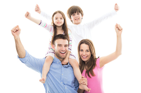 Photo pour Excited family with arms raised - image libre de droit