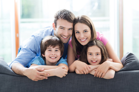 Photo pour Family sitting on couch - image libre de droit