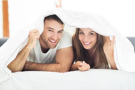Photo pour Young couple in bed - image libre de droit