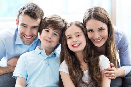 Photo pour Happy family at home - image libre de droit