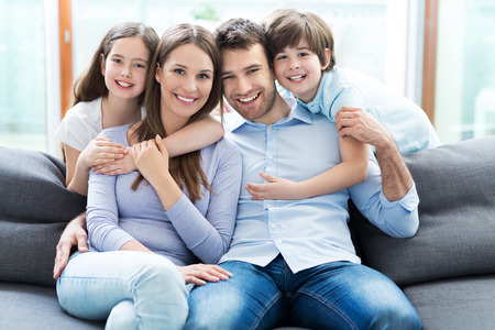 Foto per Happy family at home - Immagine Royalty Free