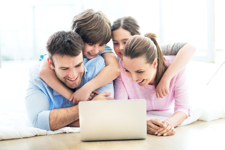 Photo for Family using a laptop at home - Royalty Free Image