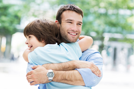 Photo for Father and son hugging - Royalty Free Image