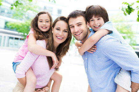 Photo for Parents giving kids piggyback ride - Royalty Free Image