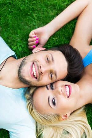 Young couple lying in grass
