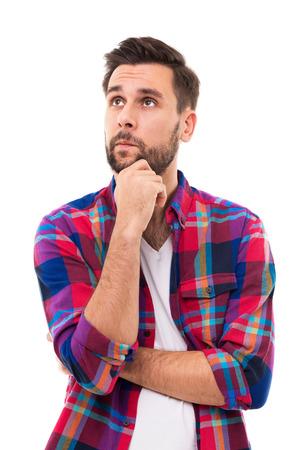 Photo pour Young man thinking - image libre de droit