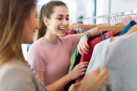 Photo for Two women shopping in a boutique - Royalty Free Image