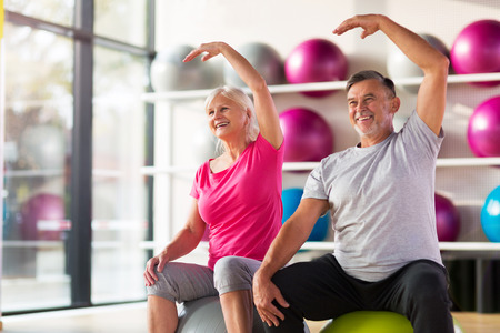 Photo for Senior couple exercising in gym - Royalty Free Image